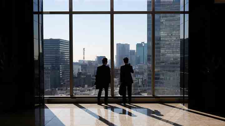 Businessmen are seen inside a high-rise office building in Tokyo November 21, 2013.