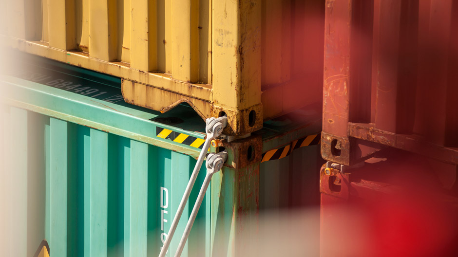 Close-up of containers on commercial cargo. Securing bars on containers